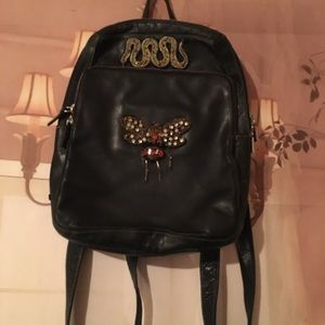 vintage leather backpack with up-cycled details